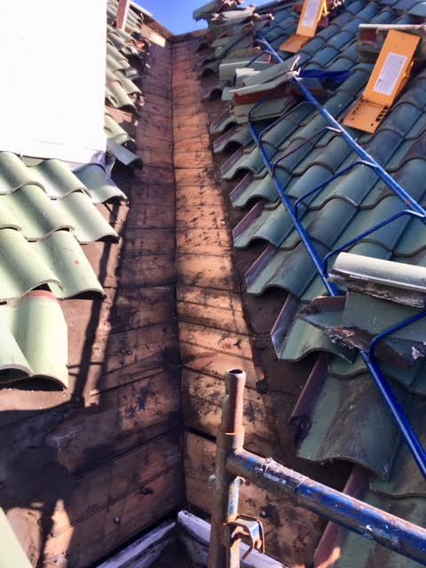 Tile Roof Valley Repair in Newton Center, MA - Before Photo