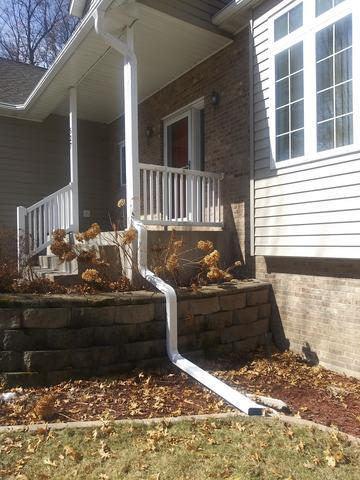 Custom LeafGuard® Gutter Downspouts in Sartell Minnesota - After Photo