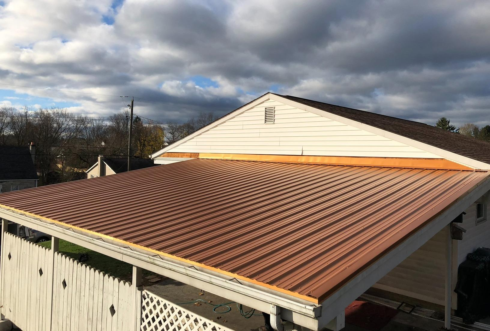 From Asphalt Shingles to Corrugated Metal Roofing Panels - After Photo