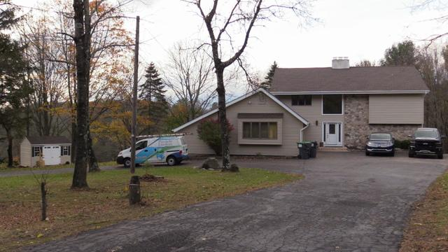 A Transformation Provided By Vinyl Siding, A New Roof, Gutters, And Pinnacle Exteriors Skilled Installation Crew