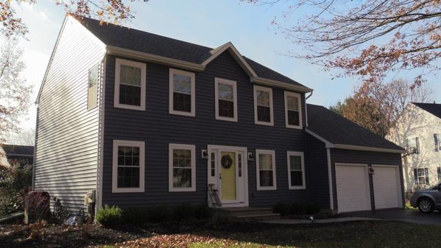 A Color Change Courtesy of Vinyl Siding, Replacement Windows, New Gutters and Pinnacle Exteriors