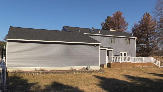 A View Before And After From The Backyard Of This Vinyl Siding Transformation in Coplay, Pennsylvania
