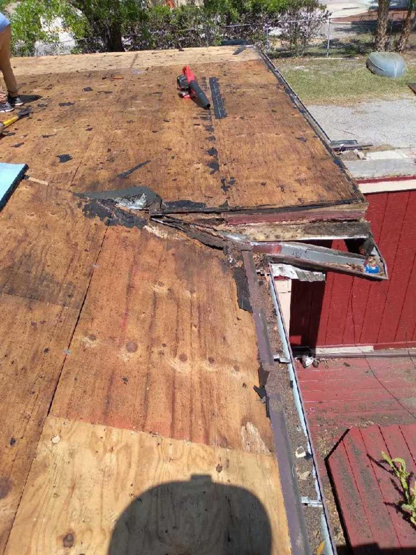 Wood Rot Flat Roof Repair - Before Photo