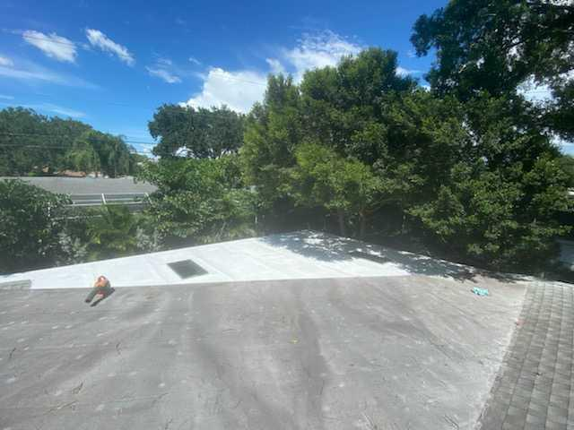 Flat Roof Re- Coat and Sky Light Repair - After Photo