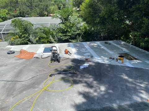 Flat Roof Re- Coat and Sky Light Repair - Before Photo