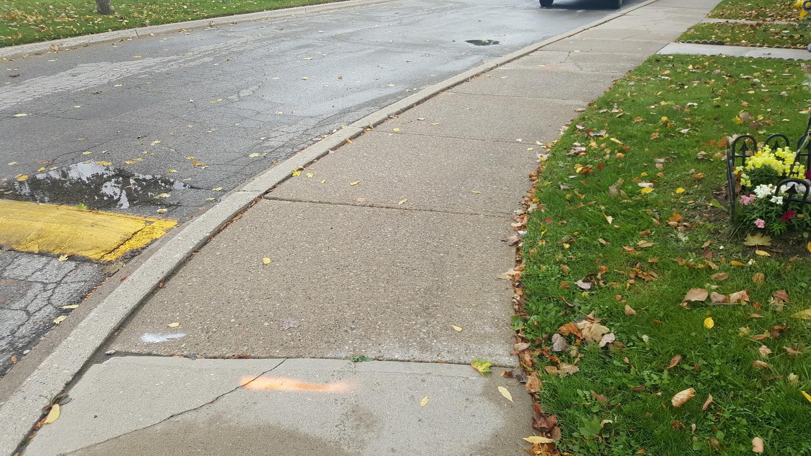 Sidewalk leveling in London, Ontario - Before Photo