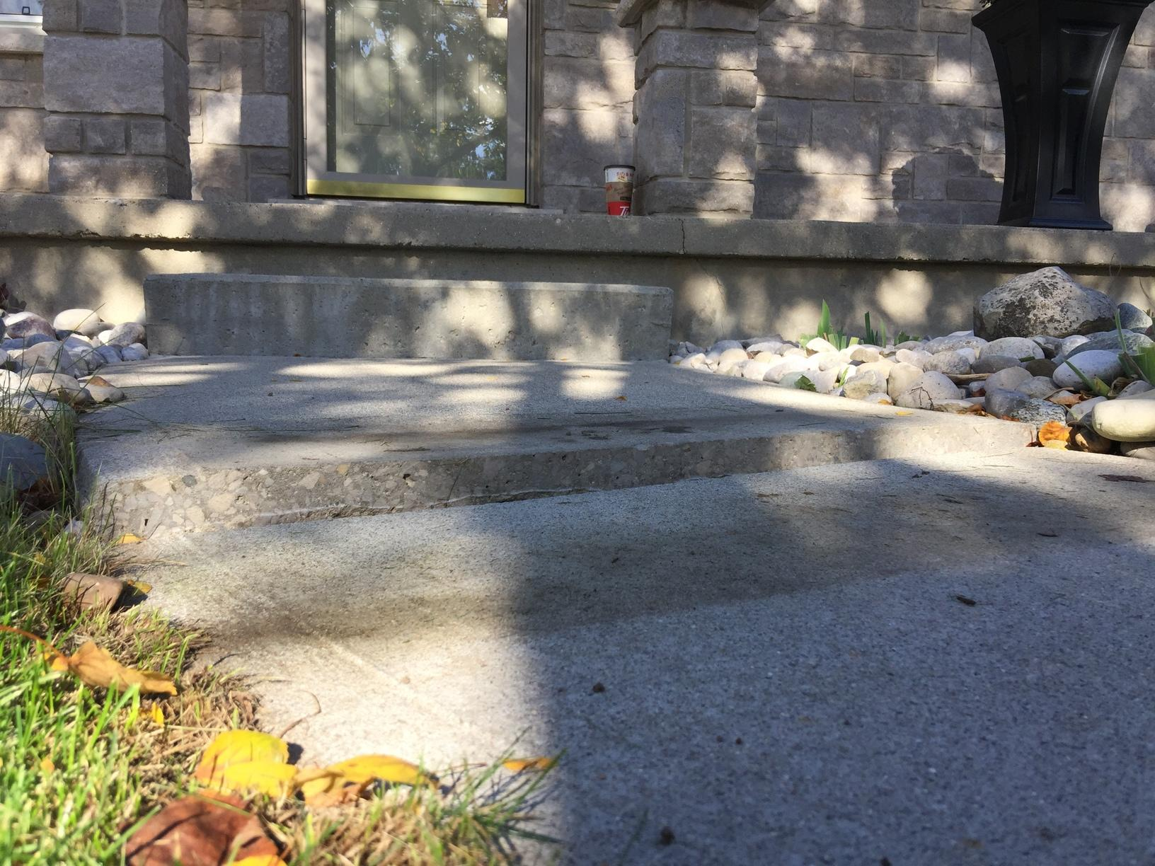 How much a walkway can sink and how effective raising it is in London, Ontario - Before Photo