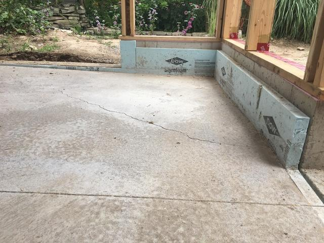 Raising concrete in Lucan, Ontario. - Before Photo