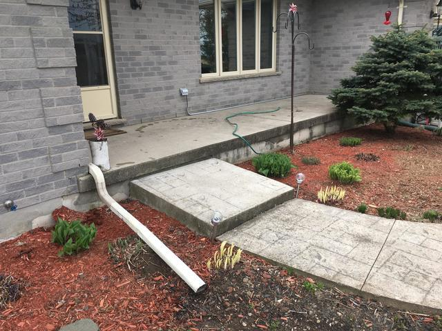 Raising a Walkway and Step in Denfield, Ontario. - Before Photo