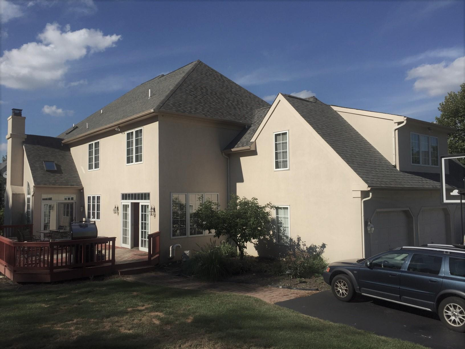 Stucco Remediation & James Hardie Siding Installation in Malvern, PA - Before Photo