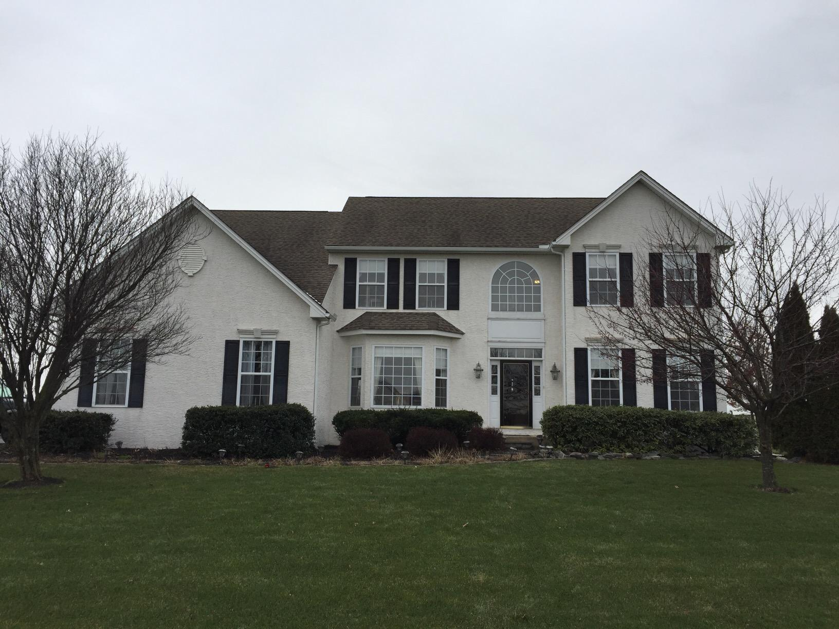 Stucco Remediation, Hardie Siding & Marvin Windows Installation in Honey Brook, PA - Before Photo