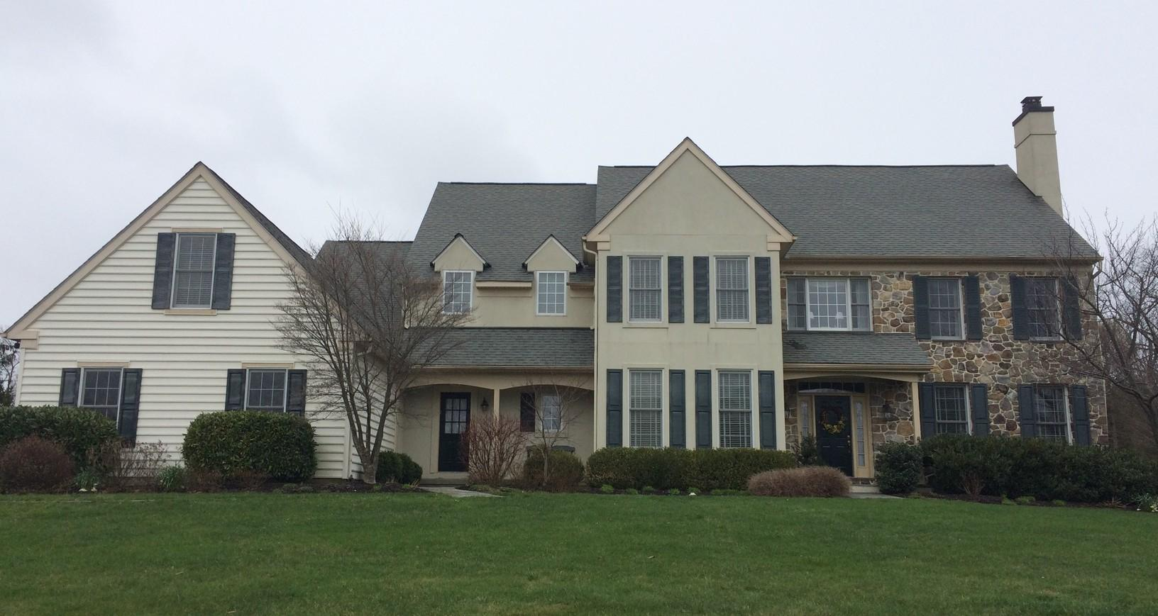 Stucco Remediation Project with James Hardie Siding in Malvern, PA - Before Photo