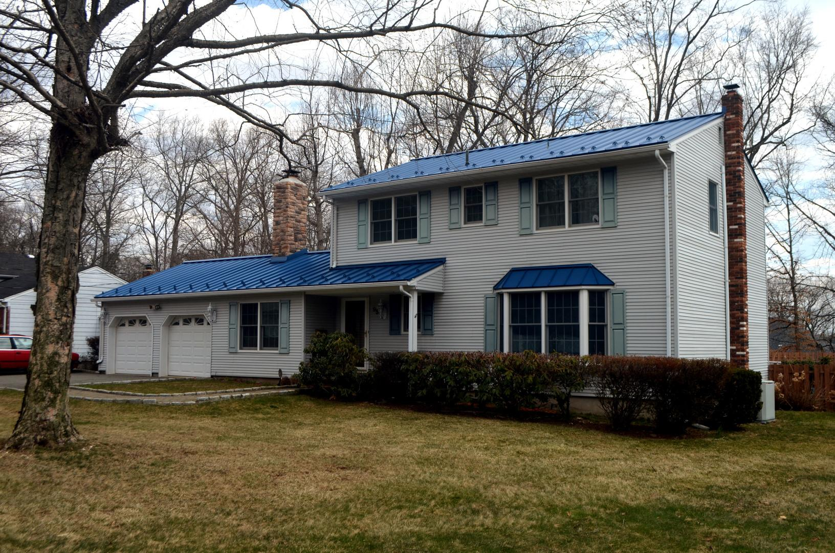 Custom Royal Blue Standing Seam Metal Roof with Snow Guards Installation in Rockaway, NJ - After Photo
