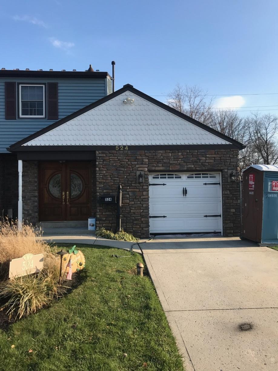 Mystic Blue GlobalTech Vinyl Siding and Rushmore ProVia Ledge Stone Siding Installation in Fairless Hills, PA - After Photo