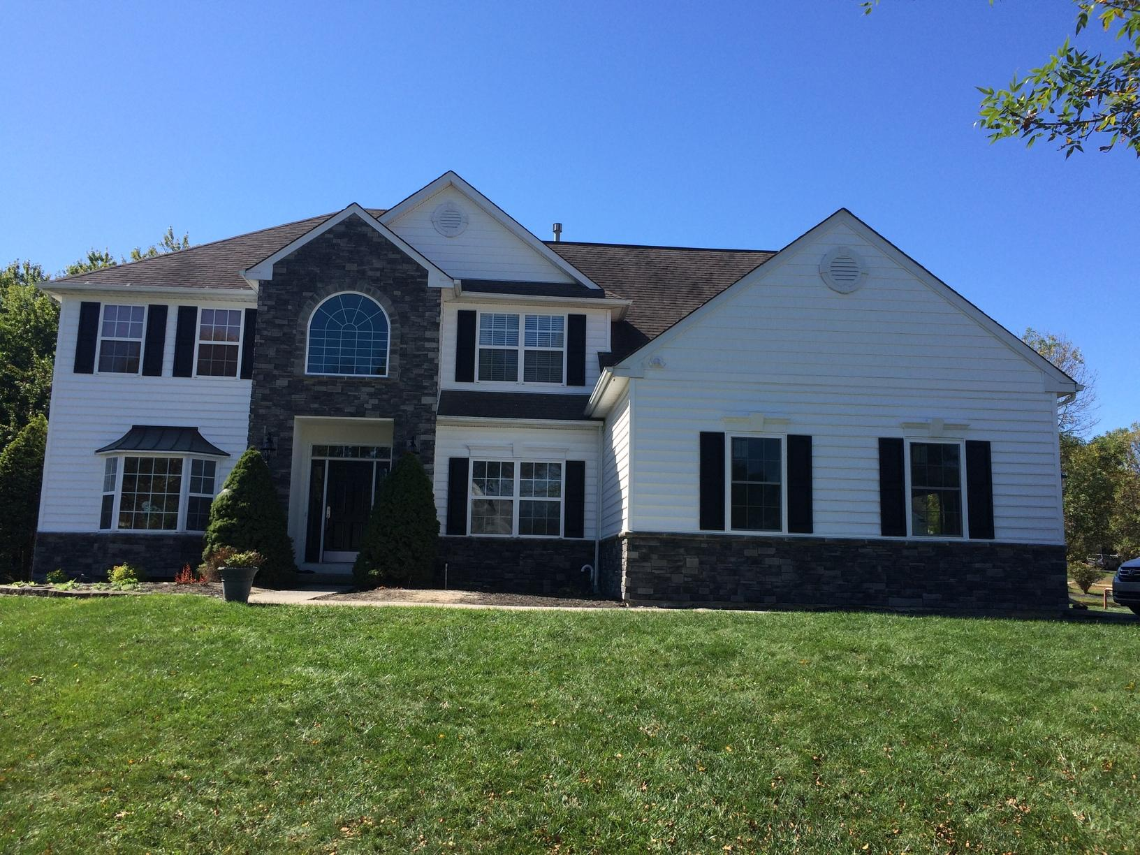 Stone and White Vinyl Siding Installation in North Wales, PA - After Photo