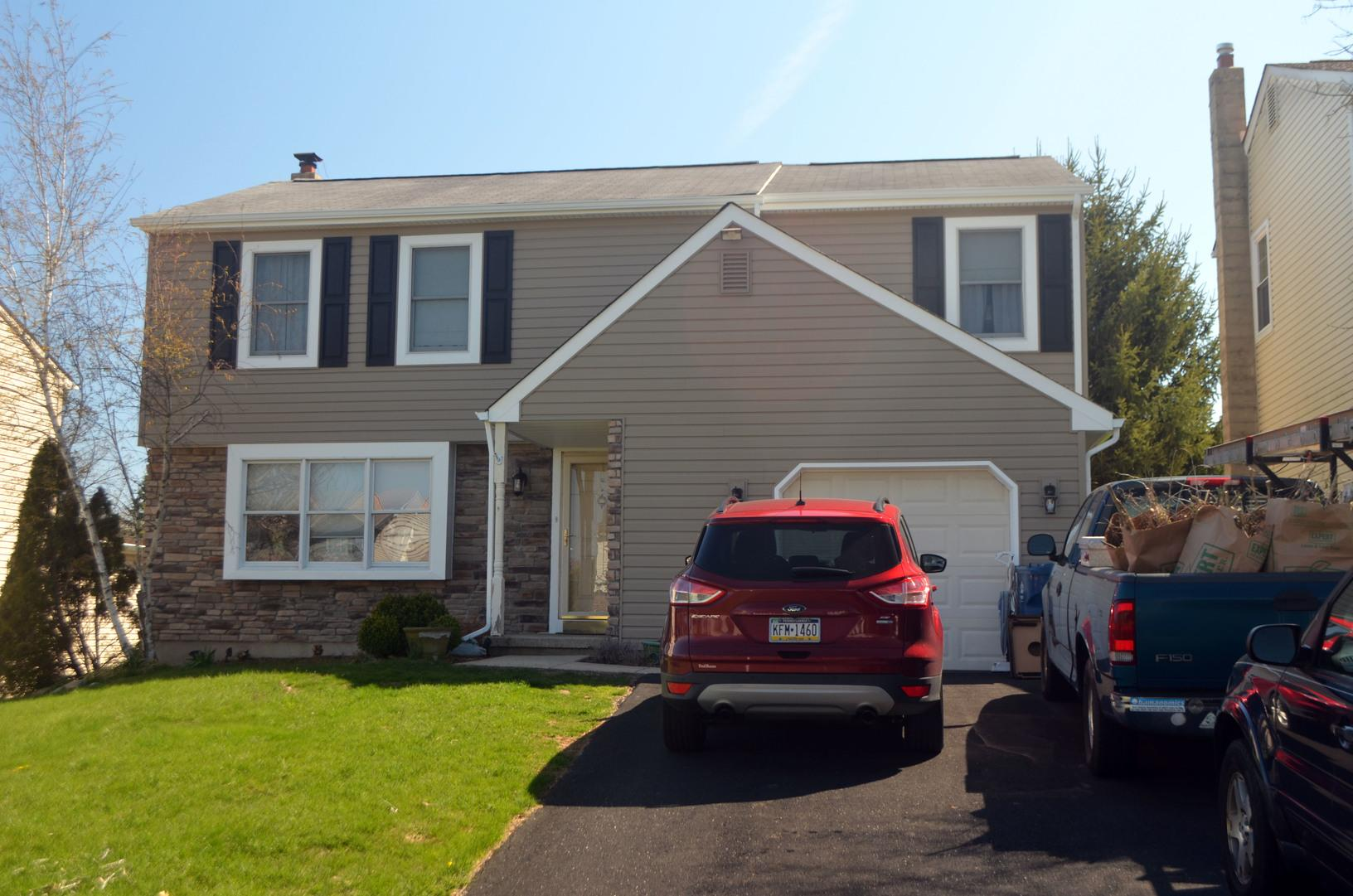 Colonial Ivory GlobalTech Insulated Vinyl and ProVia Osage Ledgestone Stone Siding Installation in Horsham, PA - After Photo