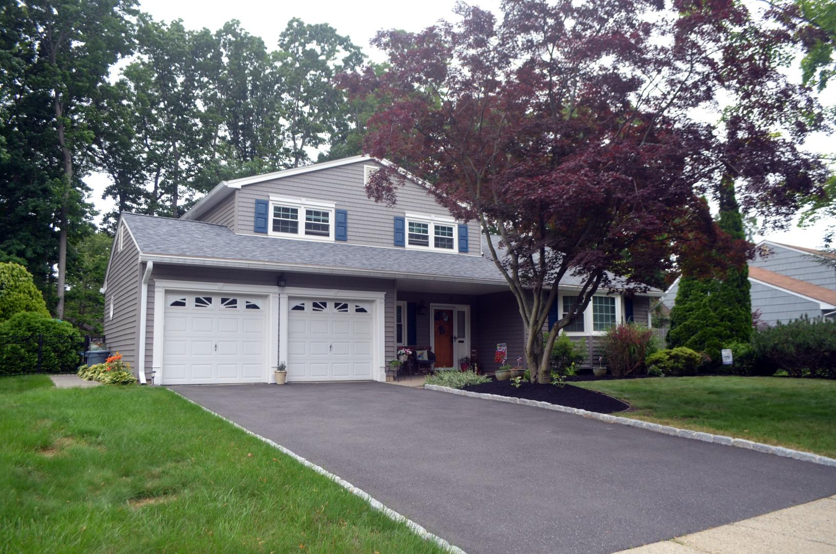 GlobalTech Vinyl Double Hung and Bay Window, Harbor Blue Odyssey Vinyl Clap Board Siding, and Owens Corning Estate Grey Architectural Shingle Installation in East Brunswick, NJ - After Photo