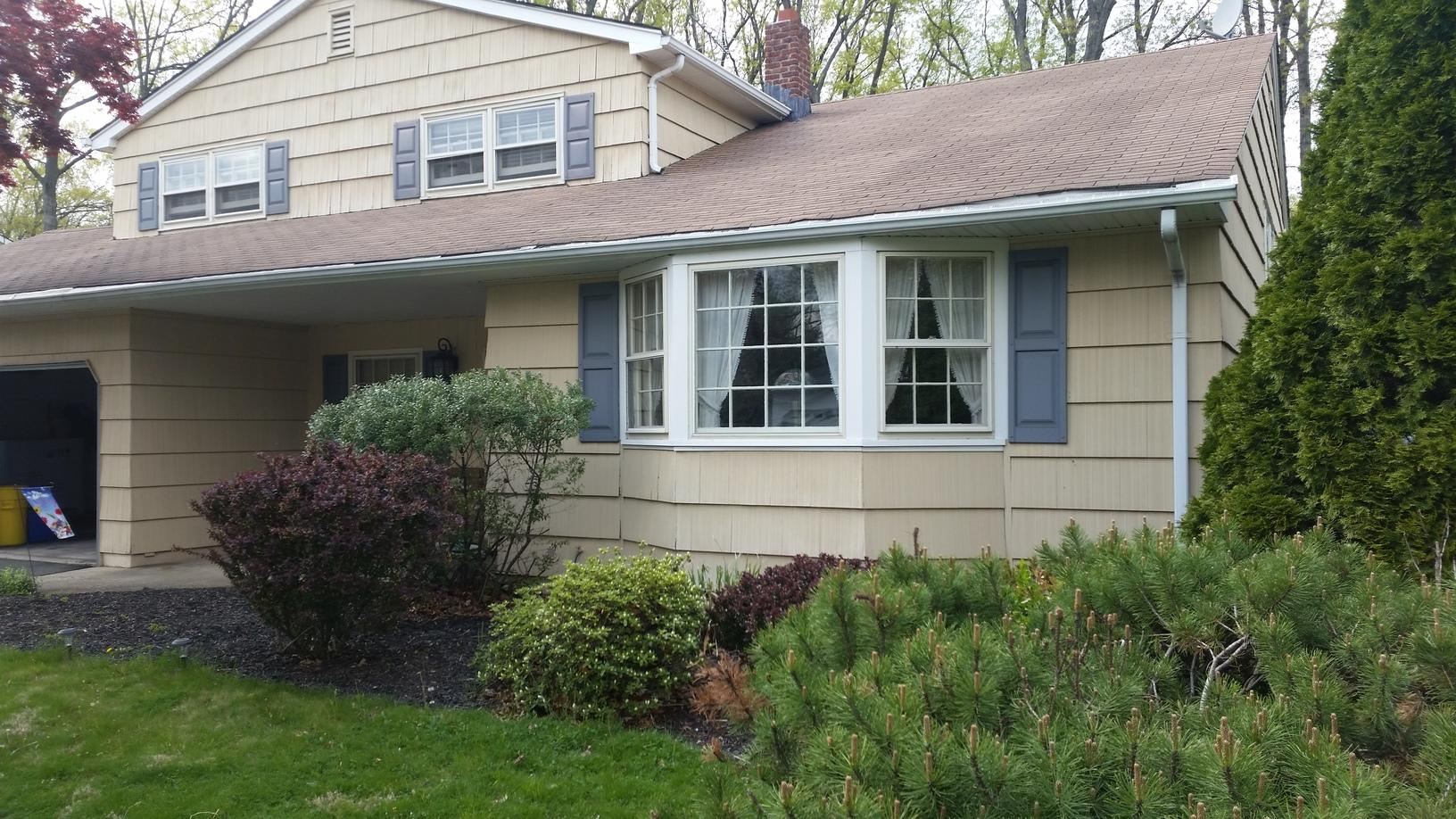 GlobalTech Vinyl Double Hung and Bay Window, Harbor Blue Odyssey Vinyl Clap Board Siding, and Owens Corning Estate Grey Architectural Shingle Installation in East Brunswick, NJ - Before Photo