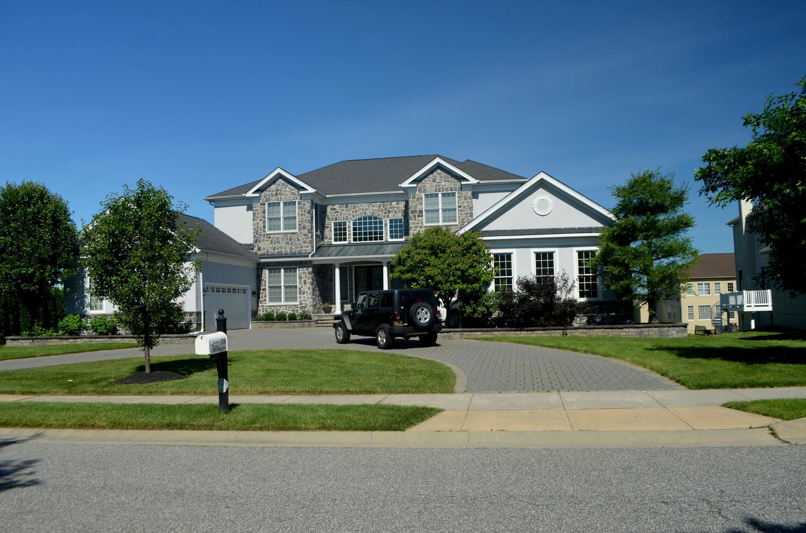 Metal Roof, Hardie Planks, and Granite Stone Installed and Stucco Replaced in Wilmington, DE - After Photo