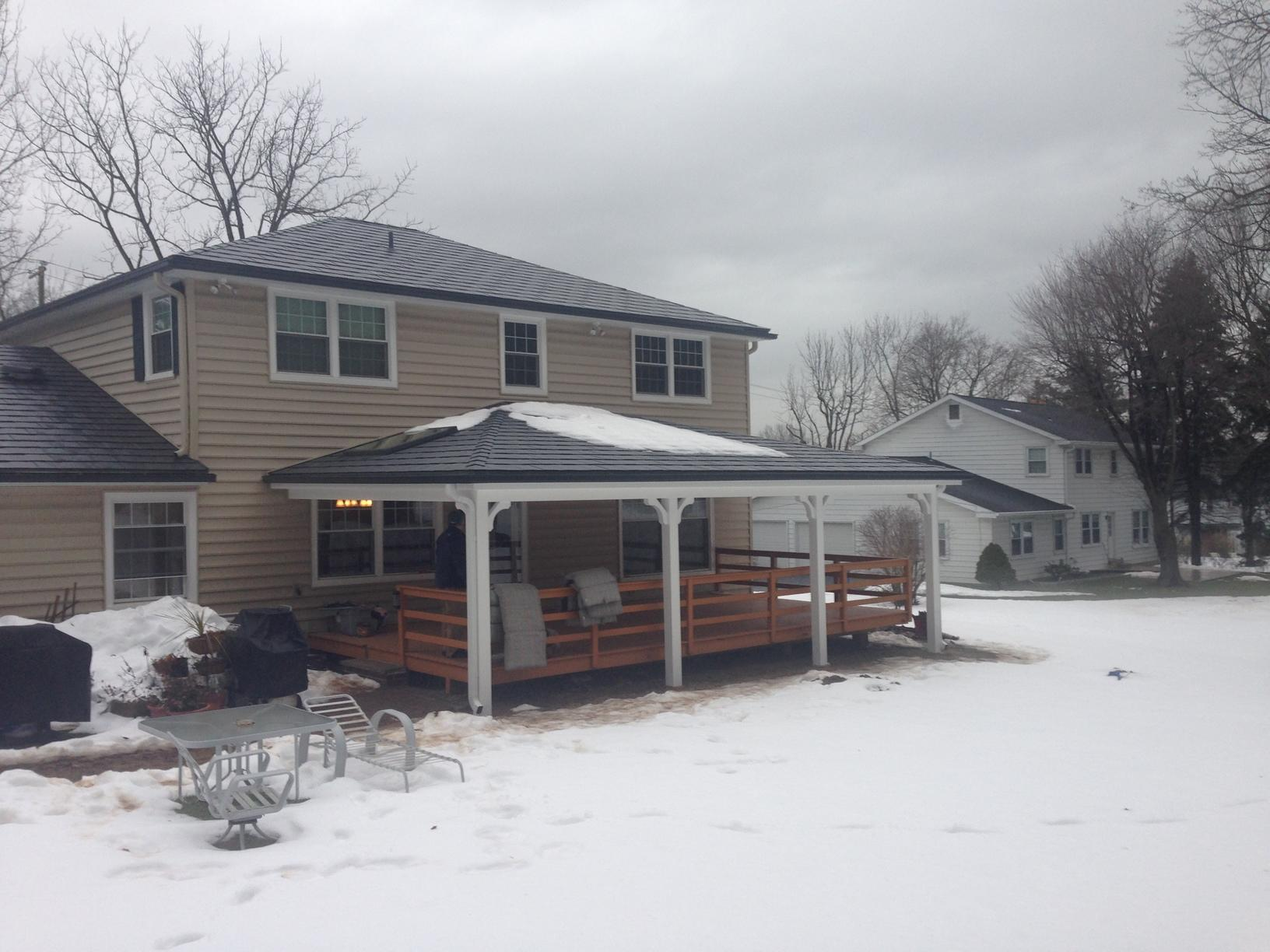 Vermont Blue Metal Slate Roof, Tuscan Clay Beaded Insulated Vinyl Siding, Custom Marvin Infinity Double Hung Fiberglass Windows, and Rear Porch Portico Installation in Lafayette Hill, PA - After Photo