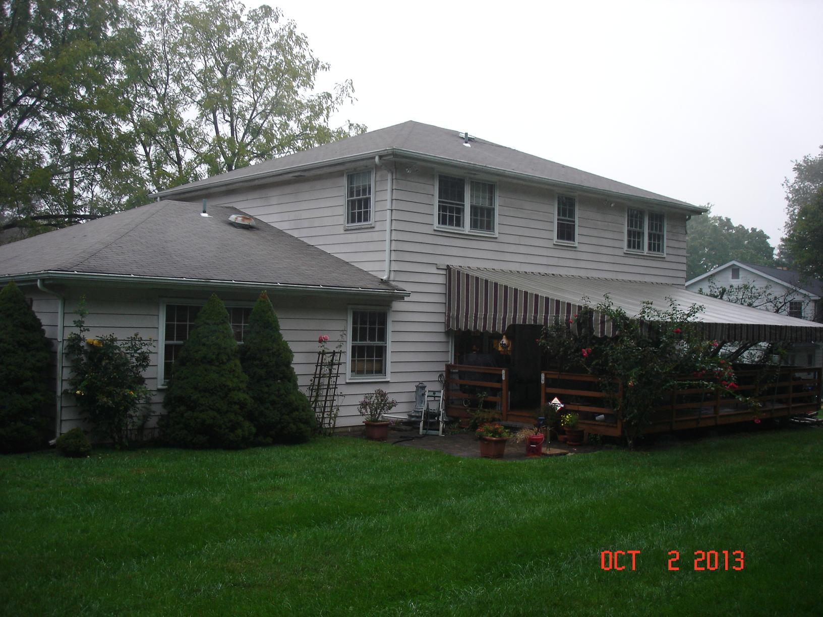 Vermont Blue Metal Slate Roof, Tuscan Clay Beaded Insulated Vinyl Siding, Custom Marvin Infinity Double Hung Fiberglass Windows, and Rear Porch Portico Installation in Lafayette Hill, PA - Before Photo