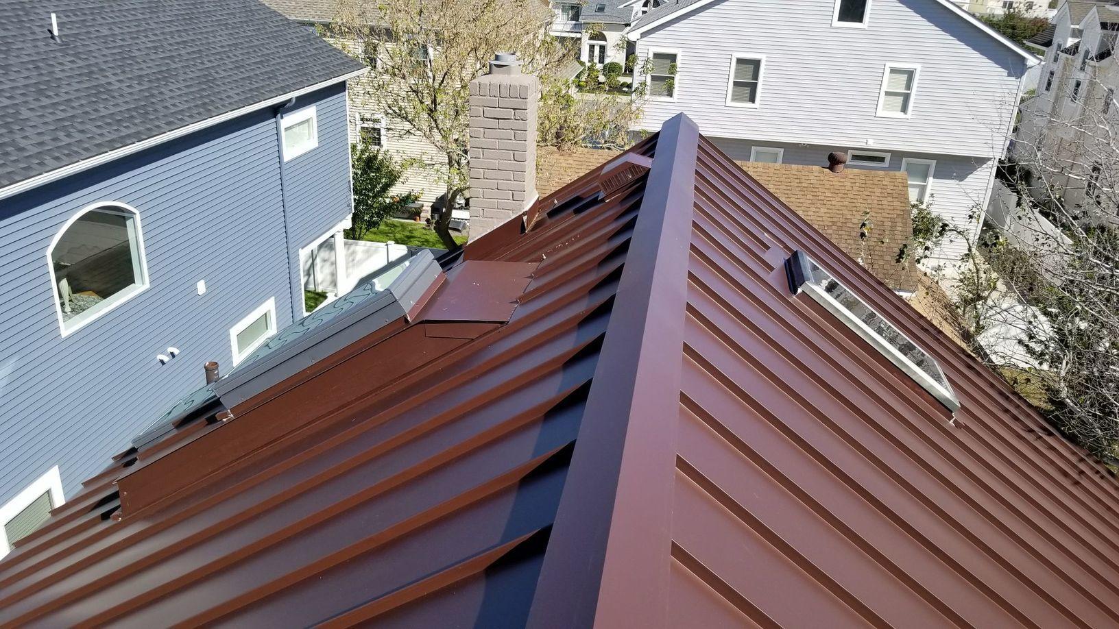 Mansard Brown Standing Seam Metal Roof Installation on Jersey Shore Home in Brigantine, NJ - After Photo