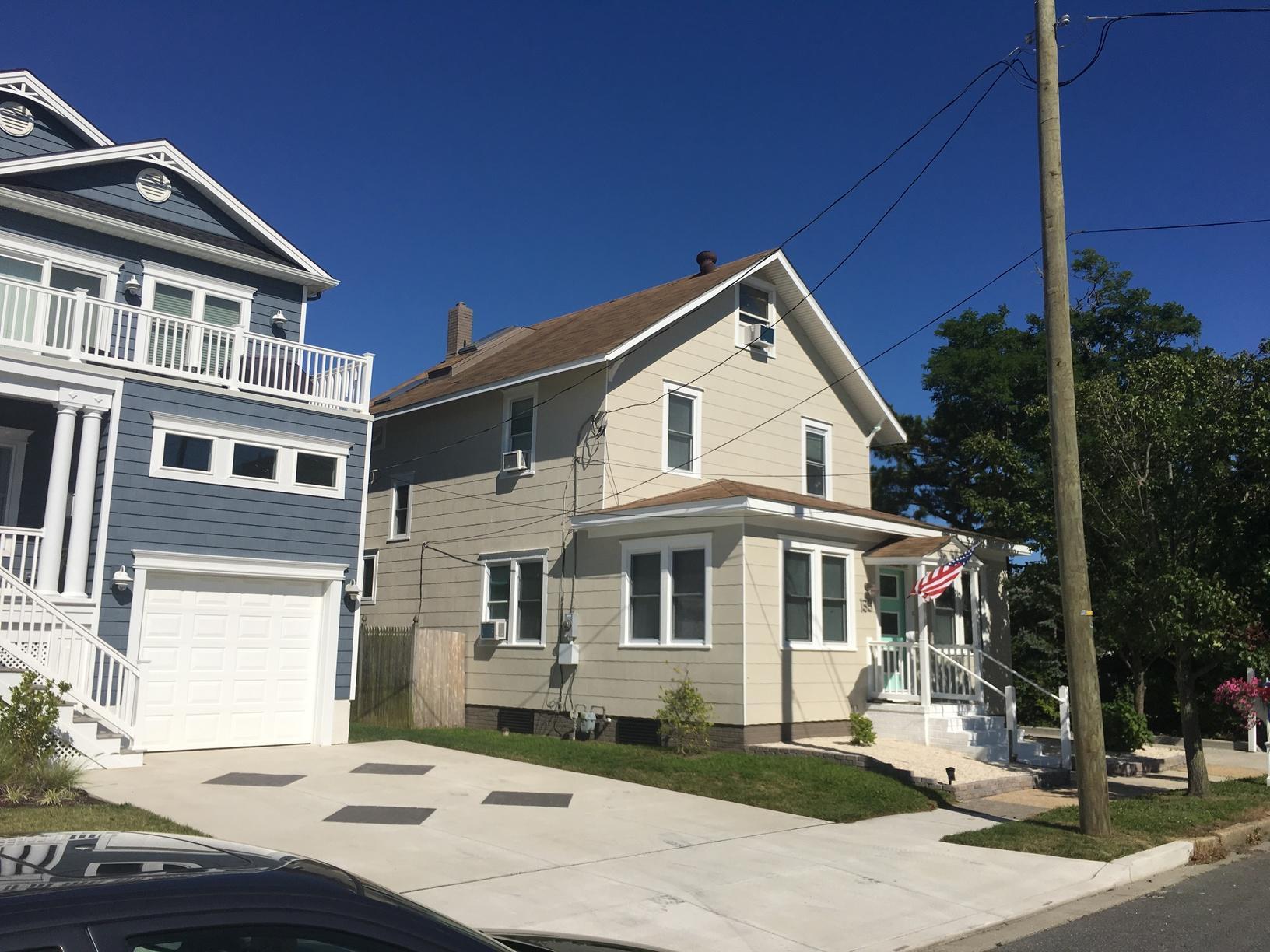 Mansard Brown Standing Seam Metal Roof Installation on Jersey Shore Home in Brigantine, NJ - Before Photo