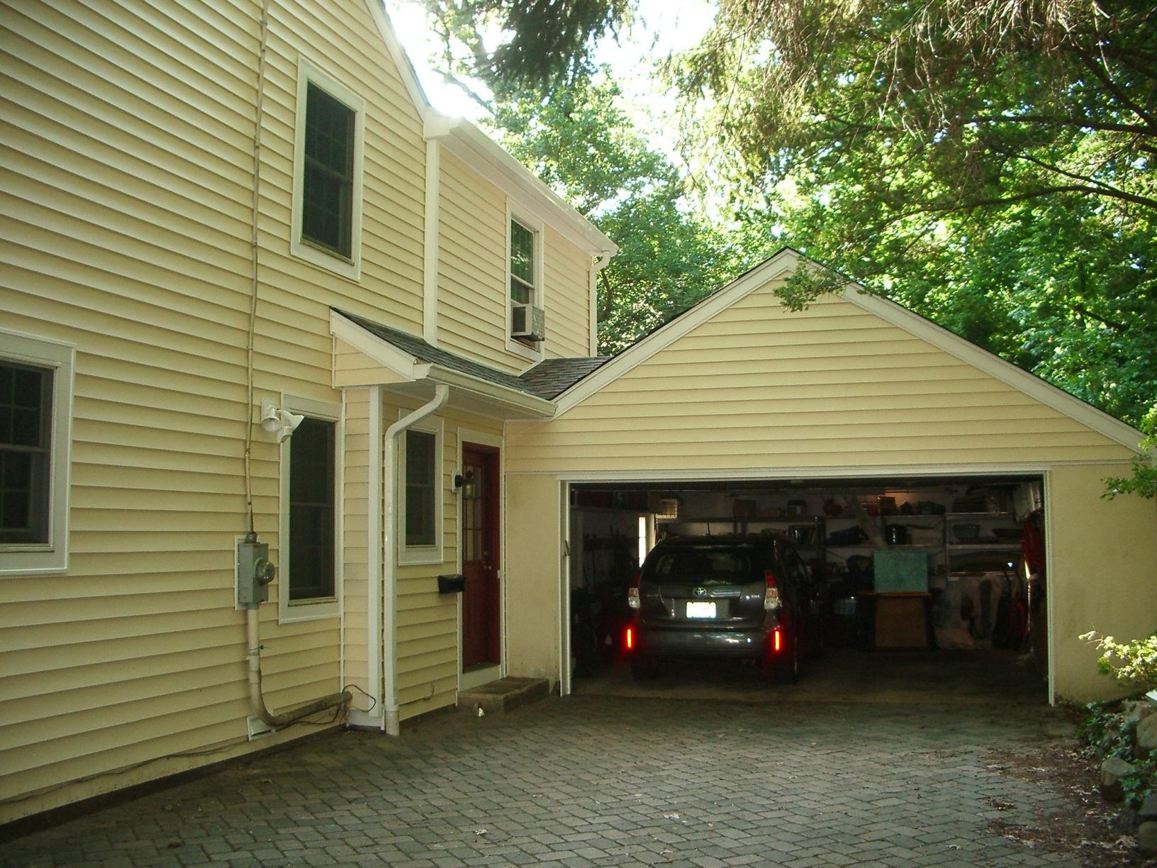 Replacing Old Wood Siding with Adobe Cream Insulated Vinyl Siding with White Trim in Mountain Lakes, NJ - After Photo