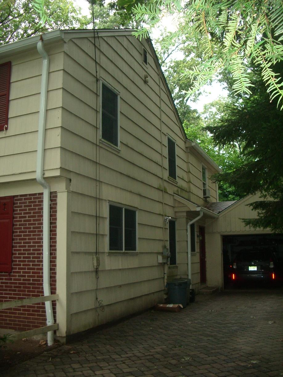 Replacing Old Wood Siding with Adobe Cream Insulated Vinyl Siding with White Trim in Mountain Lakes, NJ - Before Photo