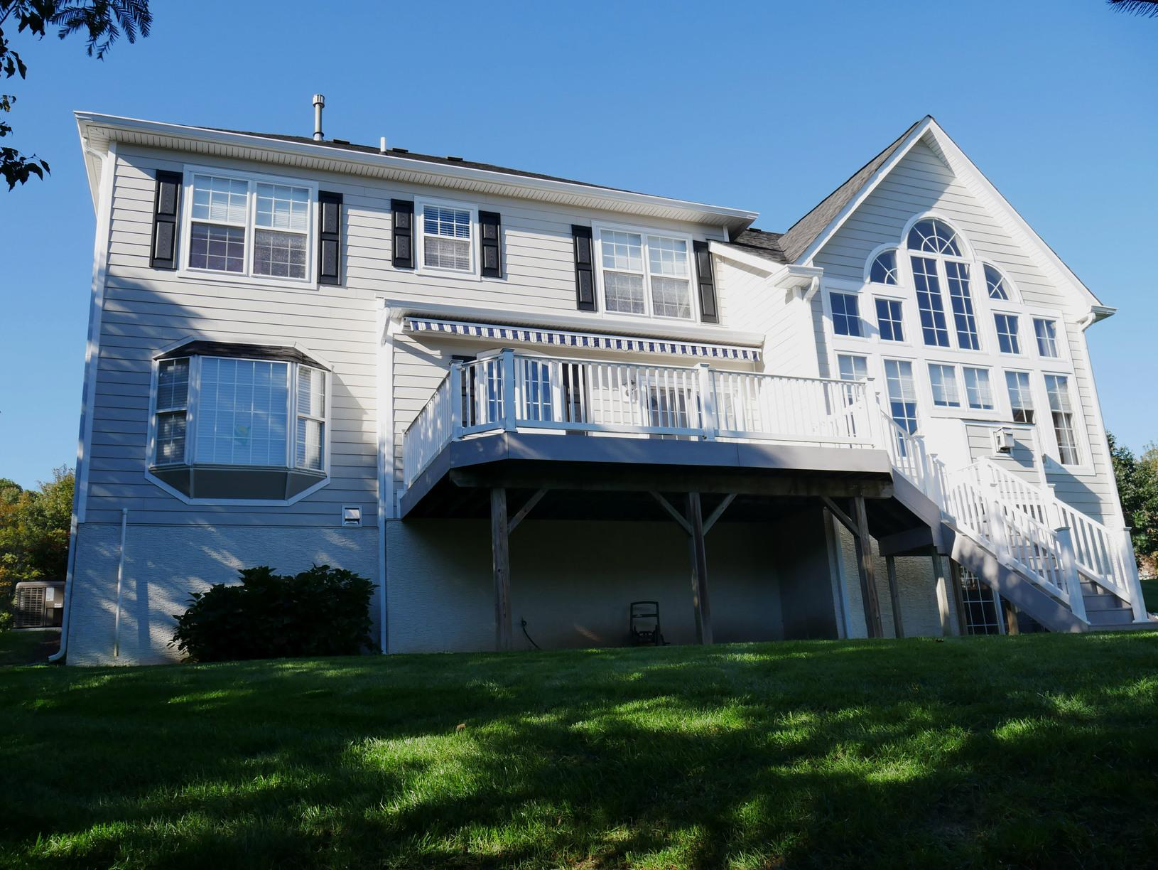 Replacing Moisture-Damaged Stucco with Hardie Planks with Cobble Stone Finish in Doylestown, PA - After Photo