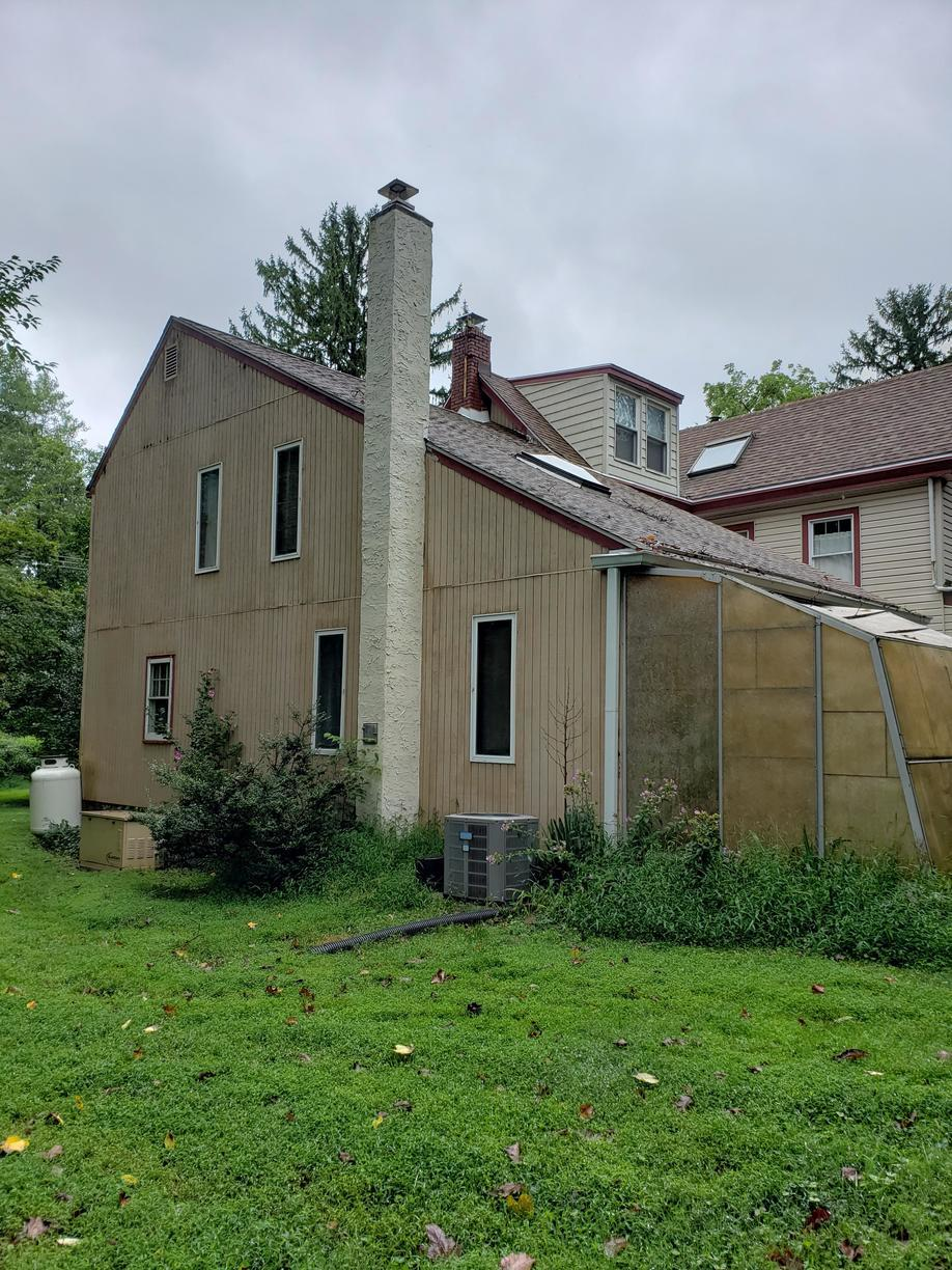 Installing Siding Over T1-11 Wood Siding in Glen Mills, PA - Before Photo