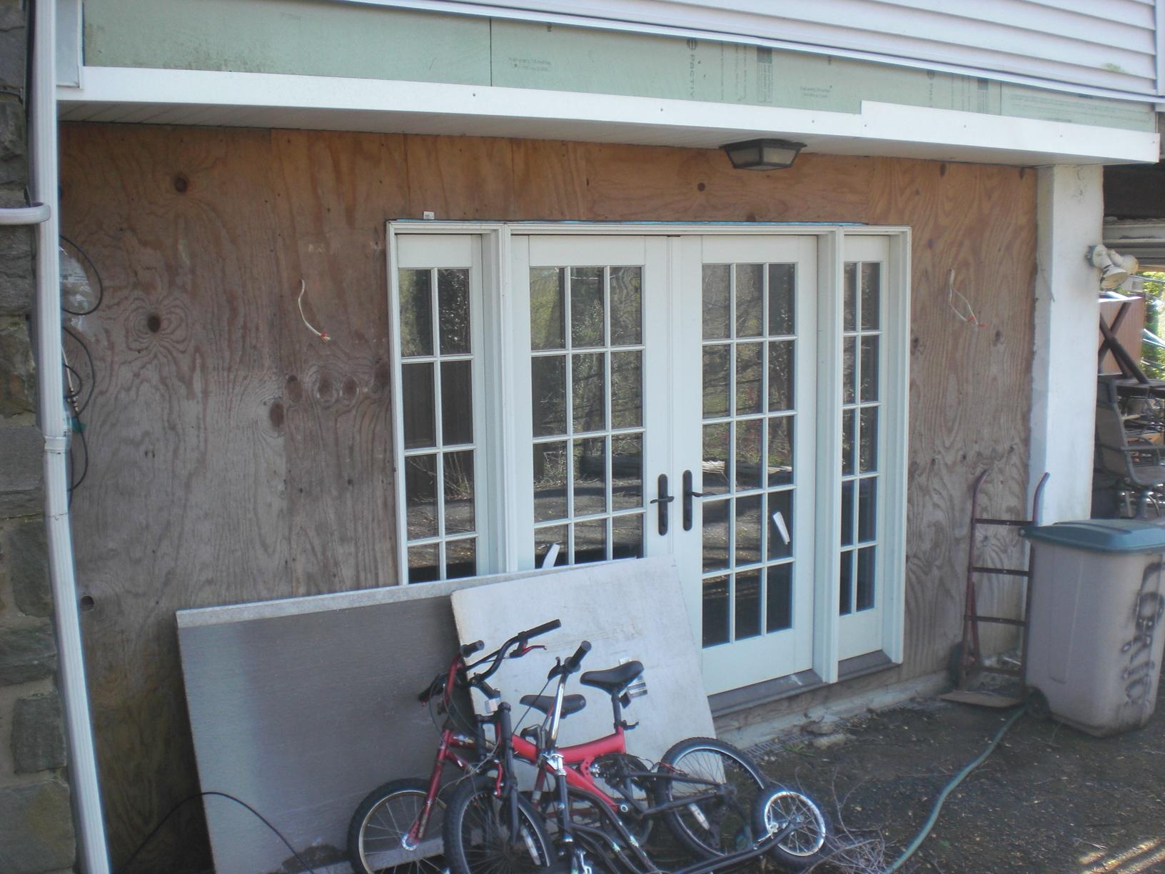 Installing Faux Stone Siding on Upper Darby, PA Home - Before Photo