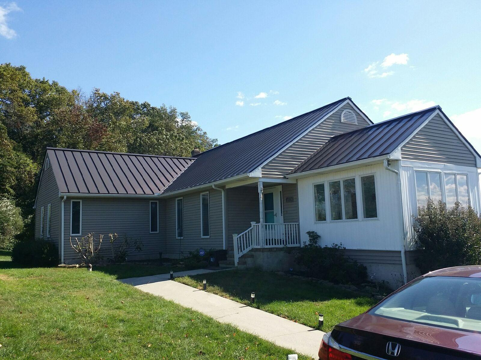 Replacing Aging Asphalt Shingles with Dark Bronze Standing Seam Metal Roof on Greenwich, NJ Home - After Photo