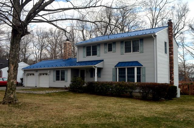 Custom Royal Blue Standing Seam Metal Roof with Snow Guards Installation in Rockaway, NJ