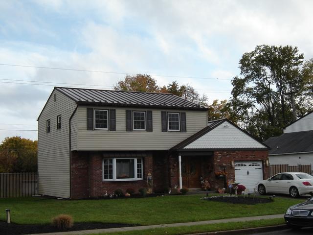 Mansard Brown Standing Seam Metal Roof Installation in Fairless Hills, PA