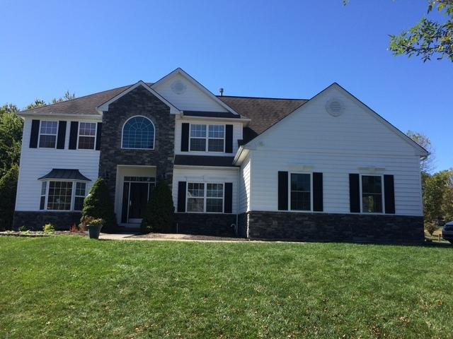 Stone and White Vinyl Siding Installation in North Wales, PA