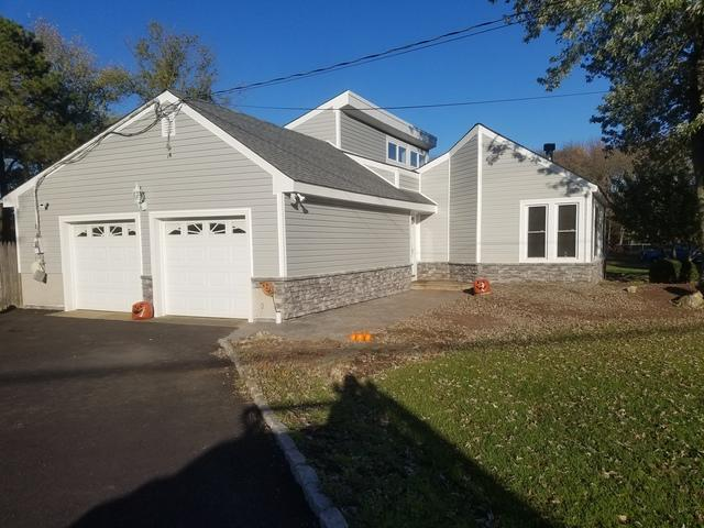 GlobalTech Premium Cape Cod Vinyl and ProVia Stone Siding Installation in Manalapan, NJ