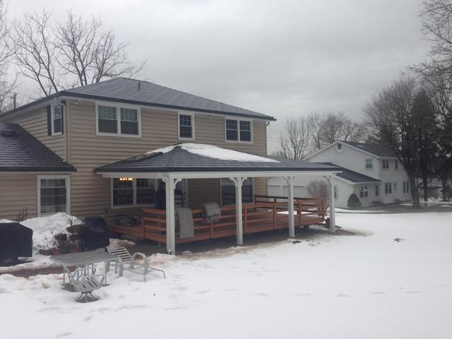 Vermont Blue Metal Slate Roof, Tuscan Clay Beaded Insulated Vinyl Siding, Custom Marvin Infinity Double Hung Fiberglass Windows, and Rear Porch Portico Installation in Lafayette Hill, PA