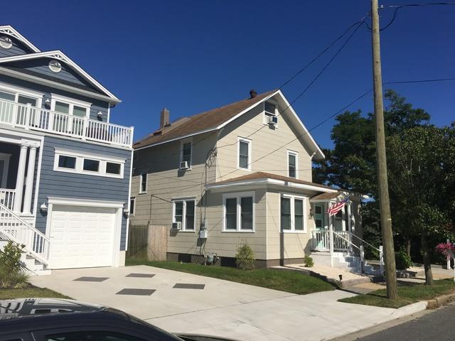 Mansard Brown Standing Seam Metal Roof Installation on Jersey Shore Home in Brigantine, NJ