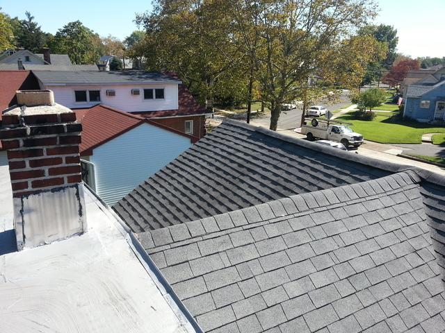 Replacing Leaking Shingle Roof with Custom Slate Grey Standing Seam Metal Roof Installation in Oaklyn, NJ