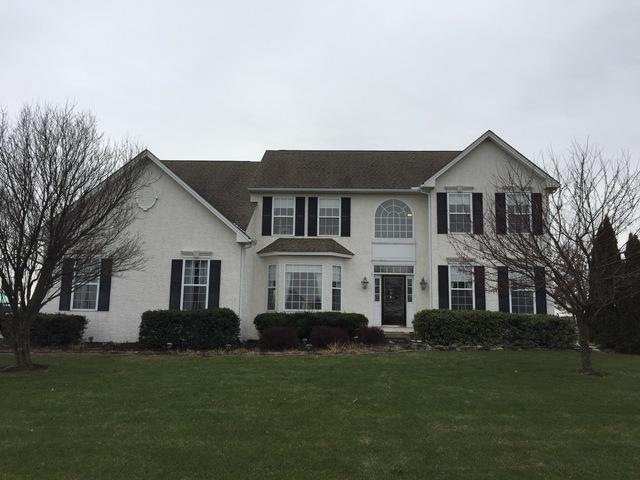 Deep Moss Prodigy Insulated Vinyl Siding, Marvin Infinity Double Hung and Half Moon Fiberglass Windows, and Concrete Portico Installed in Honey Brook, PA