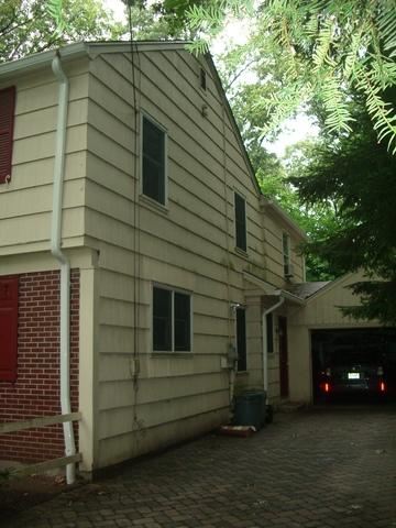 Replacing Old Wood Siding with Adobe Cream Insulated Vinyl Siding with White Trim in Mountain Lakes, NJ