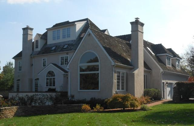 Replacing Water-Damaged Stucco with Sail Cloth Beaded Fiber Cement Planks in Newtown Square, PA - Before Photo