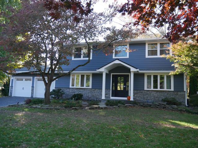 Replacing Old Vinyl With Evening Blue Fiber Cement Cedarmill Planks and Blue-Grey Stone in Doylestown, PA