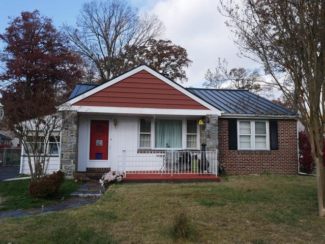 Replacing Leaky Shingles with Charcoal Grey Standing Seam Metal Roof in Woodbury, NJ