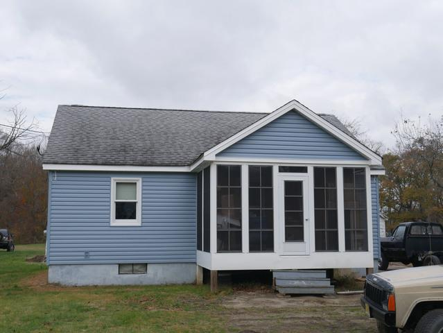 Replacing Damaged, Discolored Aluminum Siding with Mystic Blue Insulated Vinyl in Southampton, NJ