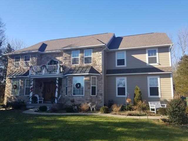 Replacing Rotting Stucco with Fiber Cement and Stone in Schwenksville, PA