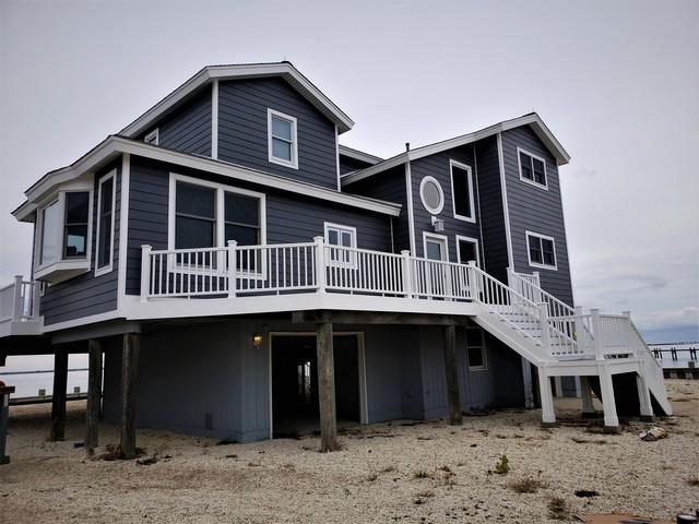 Replacing Vinyl on Jersey Beach Home with Night Grey Hardie Planks in Beach Haven, NJ