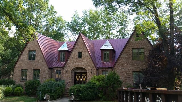 Replacing Asphalt Shingles with Burgundy Standing Seam Metal Roof in Piscataway, NJ