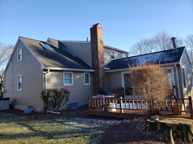 Replacing Old Cedar Shake Siding and Wood Windows with Fiber Cement Siding and Fiberglass Siding in Colts Neck, NJ